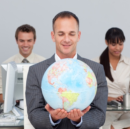 Assertive manager smiling at global expansion  photo