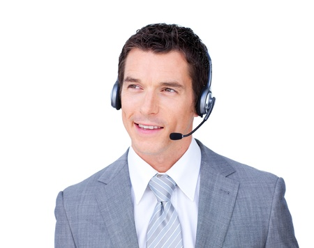 Smiling attractive businessman using headset  photo