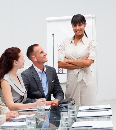 Confident Afro-American businesswoman after reporting sales figures Stock Photo - 10217855