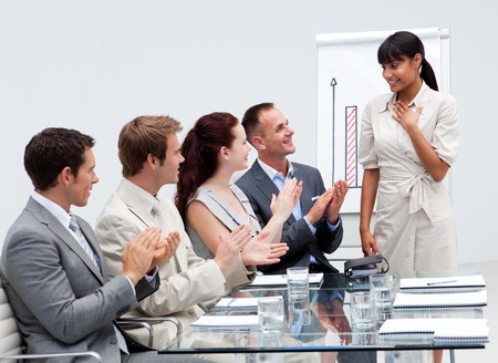 Business team applauding a colleague after giving a presentation photo