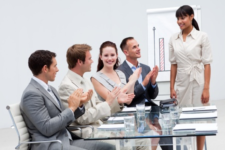 Businesswoman applauding a colleague after giving a presentation Stock Photo - 10217448