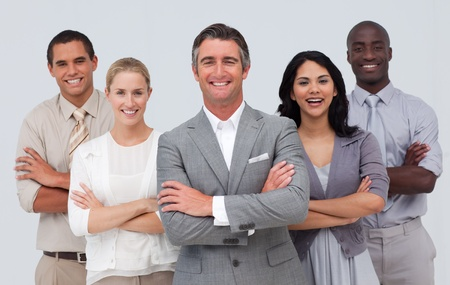 Smiling business team standing against white background photo