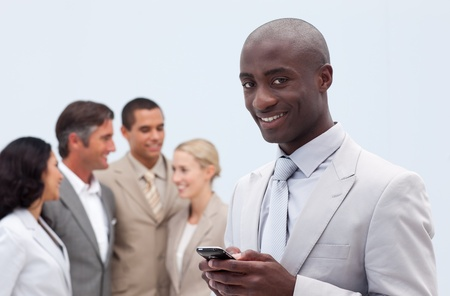 Smiling Afro-American businessman sending a message Stock Photo - 10217970