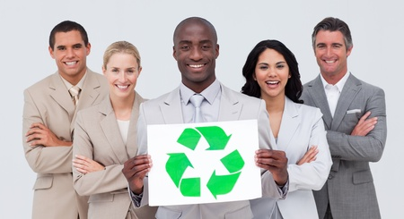 Business team holding a recycle symbol photo