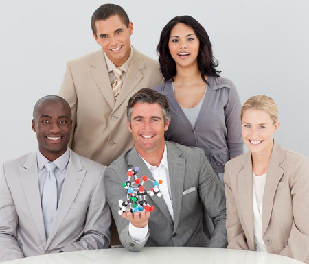 Business team holding molecules in the office photo