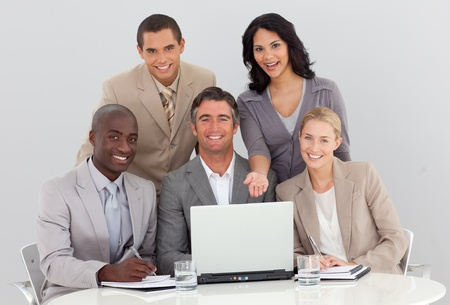 Multi-ethnic business team working in the office photo