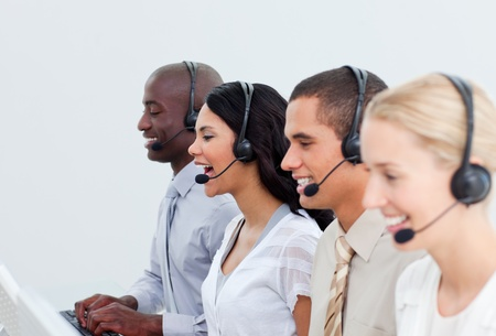 Enthusiastic business people working in a call center photo