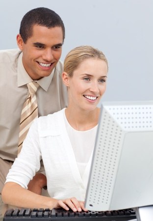 hidef: Joyful manager helping a businesswoman with her computer