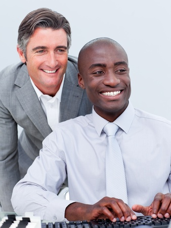 Two cheerful businessman working at a computer Stock Photo - 10217174