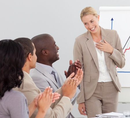Businesswoman standing smilling after a presentation photo