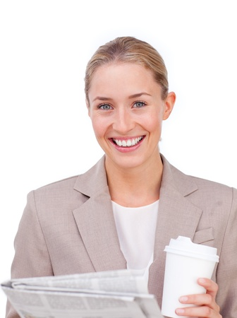 Businesswoman reading a newspaper while drinking a coffee photo
