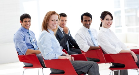 training consultant: Portrait of business people at a conference