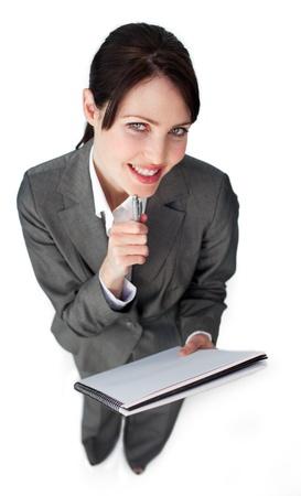 Smiling businesswoman holding glasses photo