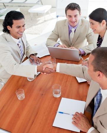 Positive Business associates closing a deal  photo