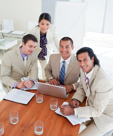 Enthusiastic business team having a brainstorming photo