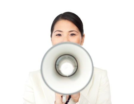Young businesswoman shouting through a megaphone Stock Photo - 10215917