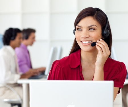 Charming Businesswoman talking on headset  Stock Photo