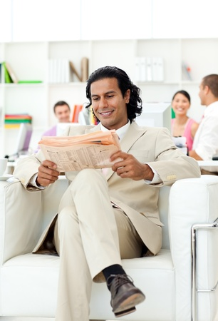 Smiling manager reading a newspaper photo
