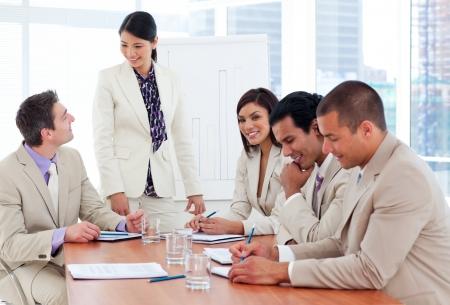 Charismatic businesswoman doing a presentation photo