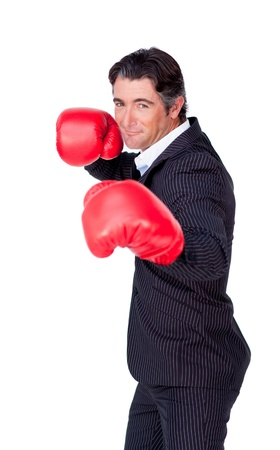 Attractive businessman wearing boxing gloves photo
