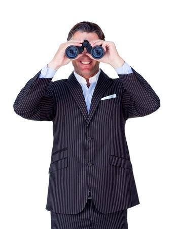 Smiling businessman looking through binoculars  photo