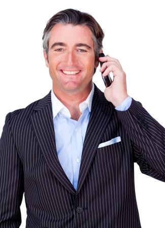 Smiling businessman on phone photo