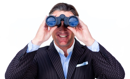 Happy businessman looking through binoculars  photo