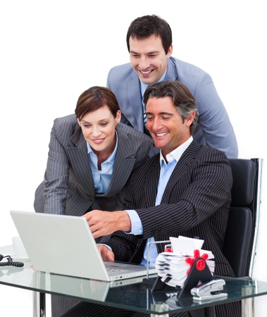 Enthusiastic business team working at a computer photo