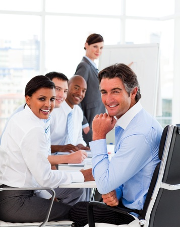 Multi-ethnic business team at a meeting photo