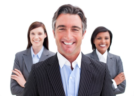 Zelfverzekerd zakenman poseren voor zijn team Stockfoto