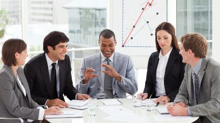 new strategy: Multi-ethnic business team discussing a new strategy