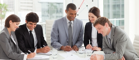 A diverse business group studying a budget plan Stock Photo - 10259424