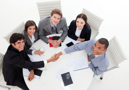 A diverse business group closing a deal photo