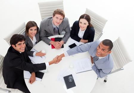 closing: A diverse business group closing a deal