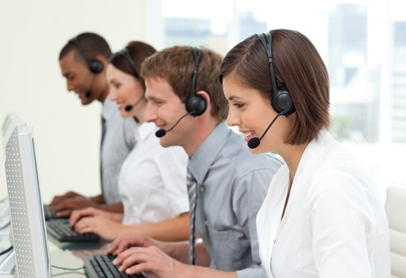 Multi-ethnic business people in a call center Stock Photo