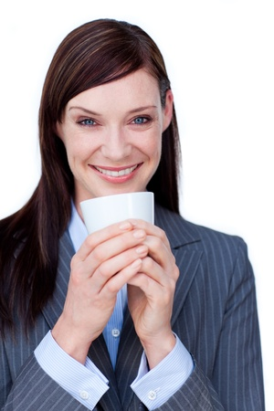 Laughing businesswoman drinking a coffee  Stock Photo - 10258312