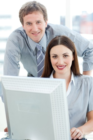 Manager and his employee smiling at the camera Stock Photo - 10259322