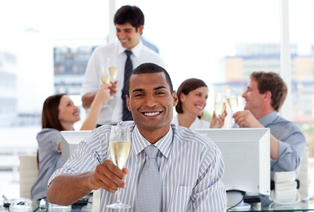 fortunate: Fortunate business team drinking champagne Stock Photo
