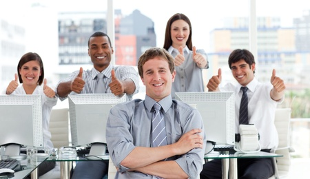 Positive business people with thumbs up  photo