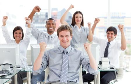 Ambitious business team celebrating success photo