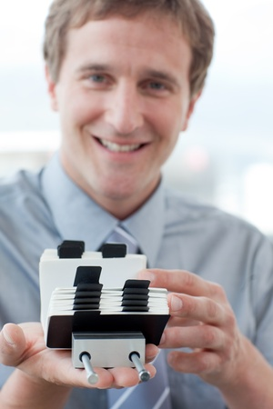Young businessman searching for the index Stock Photo - 10256799