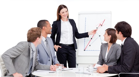 assertive: Assertive businesswoman giving a presentation