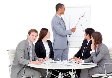 Self-assured businessman reporting sales figures Stock Photo - 10244662