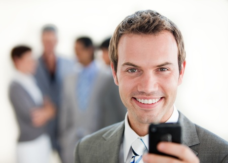 businessman phone: Charming businessman sending a text