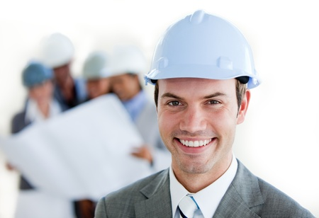 business consultant: Smiling arhitect with a hardhat  Stock Photo