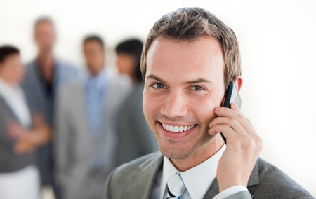 Focus on a smiling businessman on phone  photo