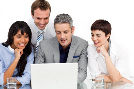 Multi-ethnic business team using a laptop photo