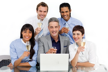 successfull: Successfull business team toasting with Champagne
