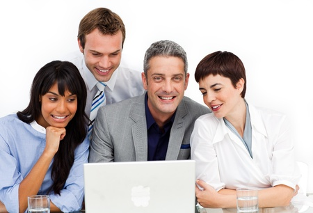 A diverse business group using a laptop  photo