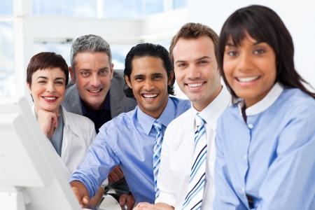 Multi-ethnic smiling business team sitting in a row Stock Photo - 10257983